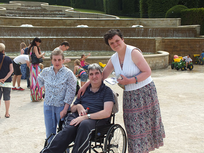 Wheelchair bound and able bodied service users on a day out