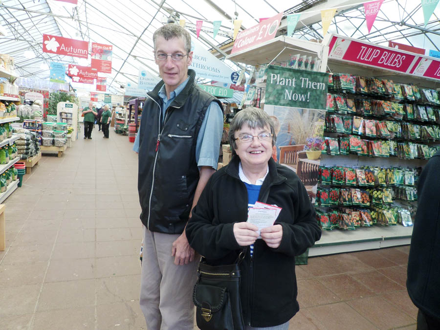 Service users buying seeds from a garden centre
